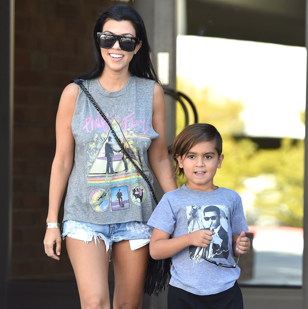 Kourtney Kardashian wearing a Pink Floyd shirt along with Mason leave a Office Building